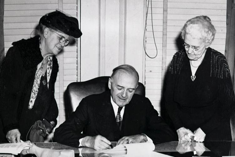 Graeme McGregor Smith, Governor McCord and Mary Daniel Moore at the signing of the bill to build the new Library and Archives, 1947.