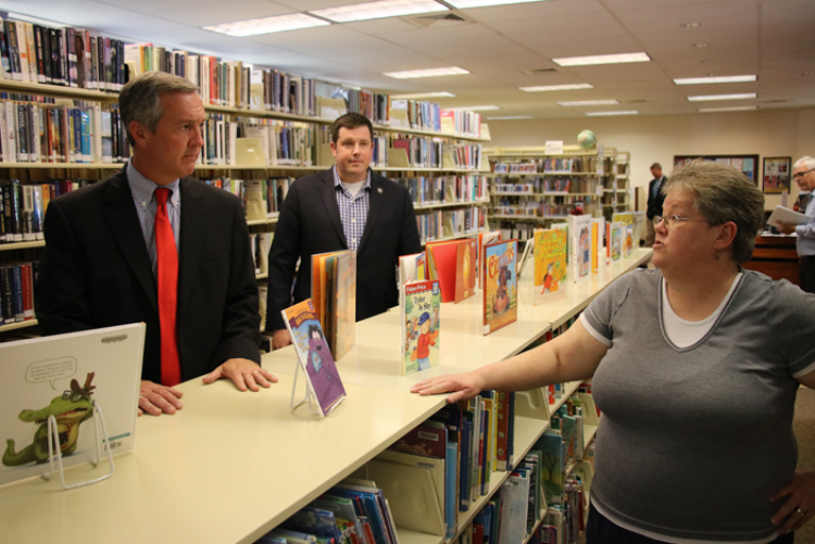 Library Director Linda Icenhour tells Sec. Hargett and Rep. Hill what the expansion will mean for patrons.