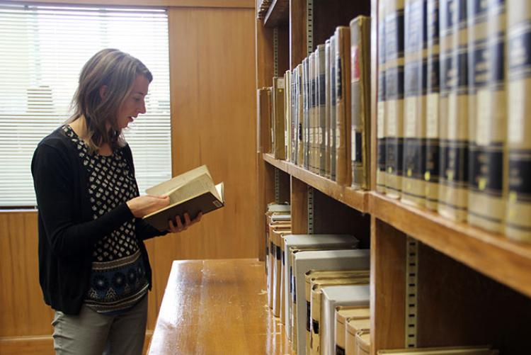picture of a woman browsing legal records at the State Library